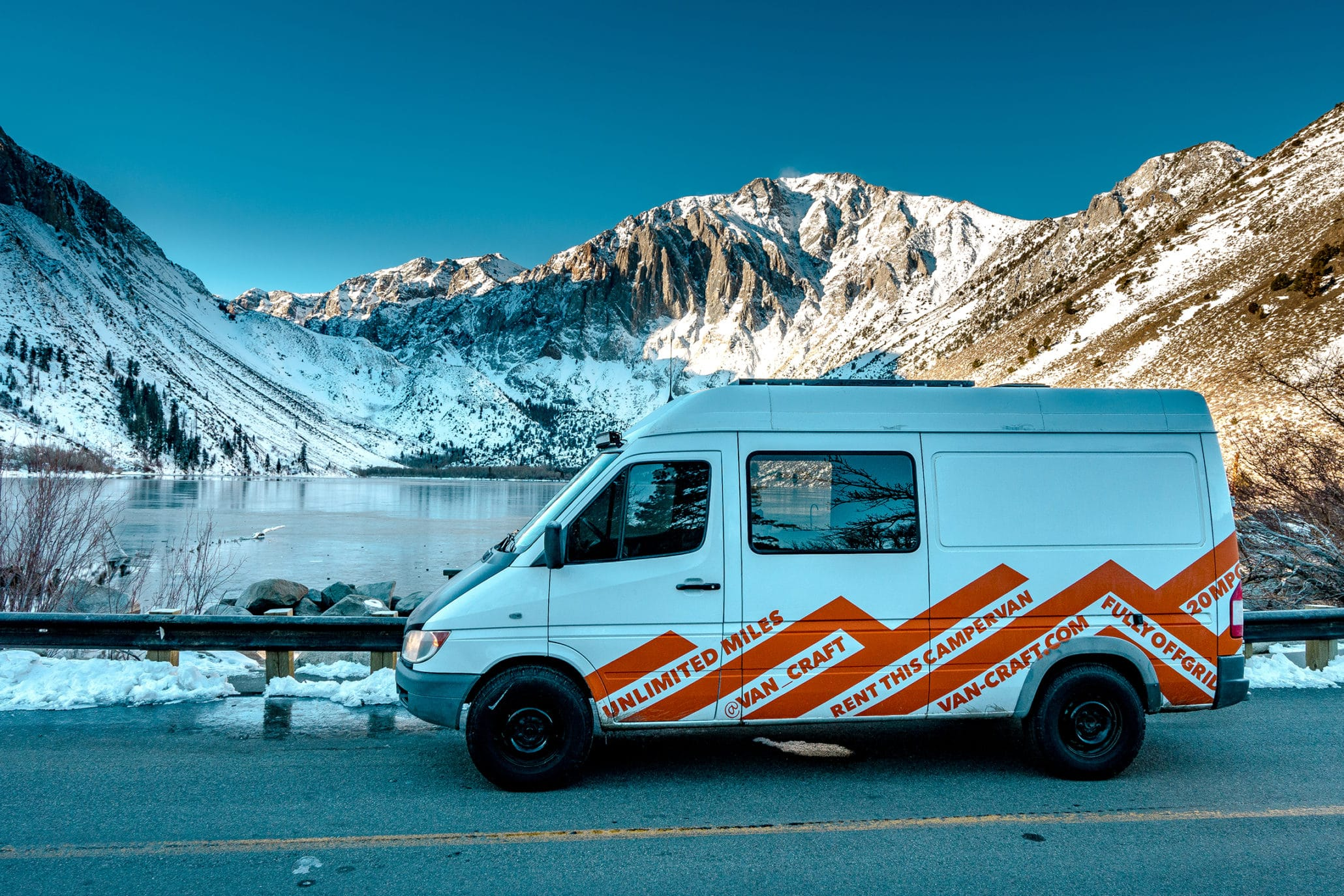 unreal view of convict lake in winter from a campervan